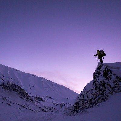man on mountain with snow