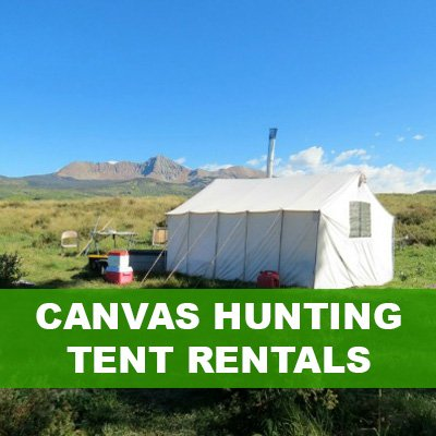 canvas wall tent in mountains