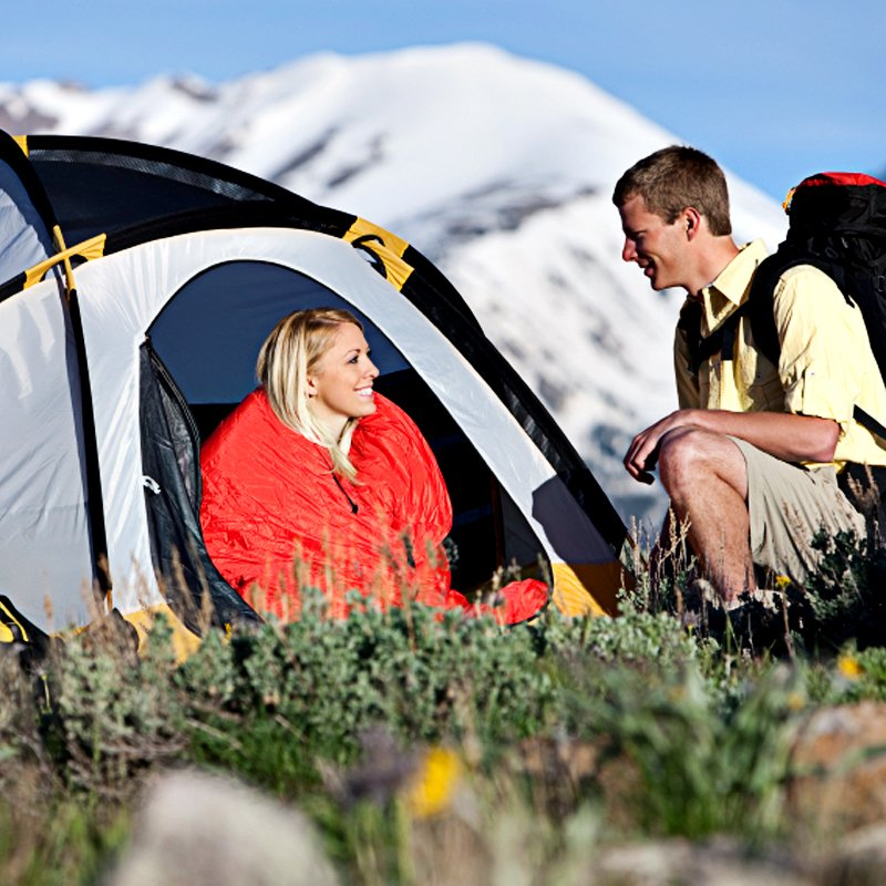 couple next to camping tent