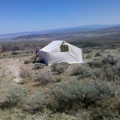 wall tent on hillside