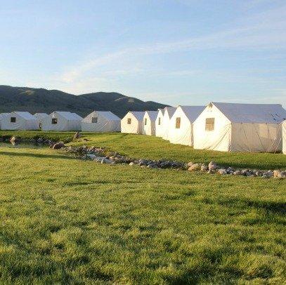 Canvas tents near stream