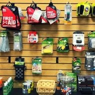 backpacking and camping accessories on a wall