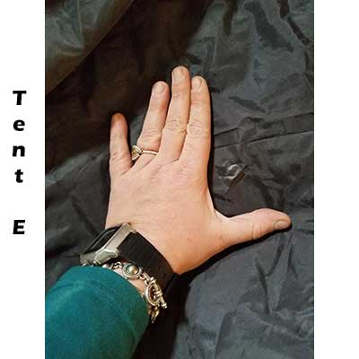 Repair on floor of tent E